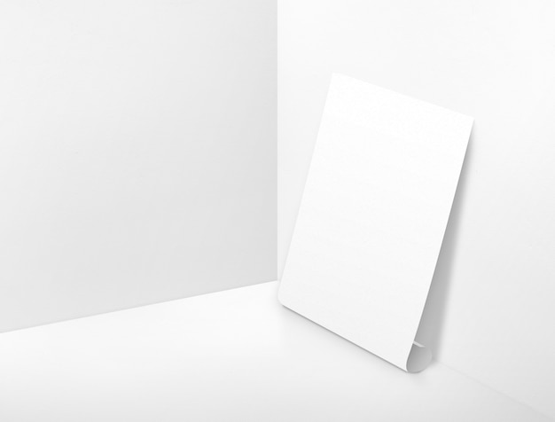 Blank white rolling poster at corner painted white color studio room background