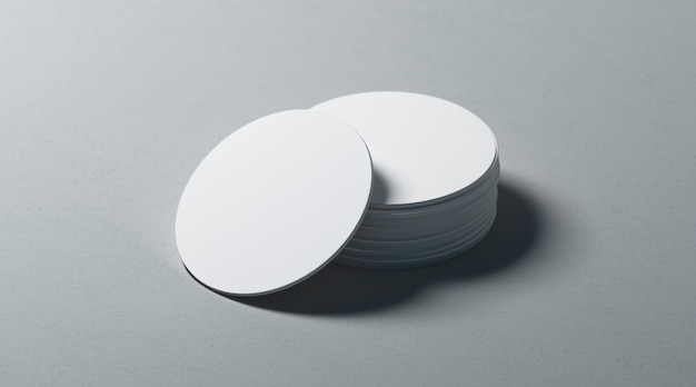 Blank white round beer coasters stack  on textured surface
