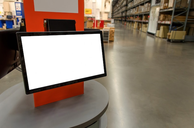 Blank white screen monitor on counter desk at cargo warehouse in factory