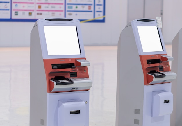 Blank white screen self service or machine automatic check-in machines in the airport
