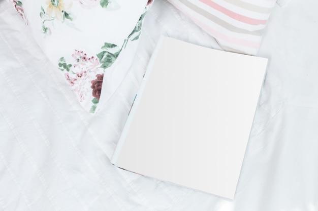 Blank white sheet, open magazine, catalogue