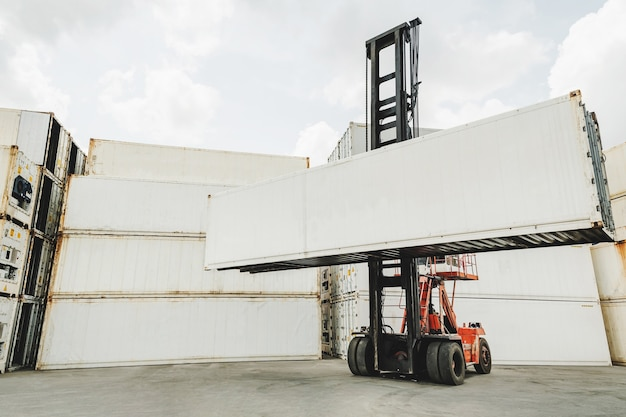 Blank white shipping cargo container loading on forklift truck for transportation shipping and logistic