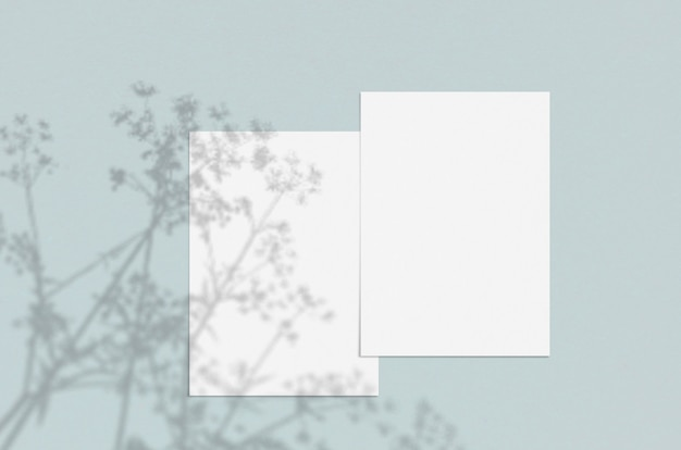 Blank white vertical paper sheet with shadow overlay.
