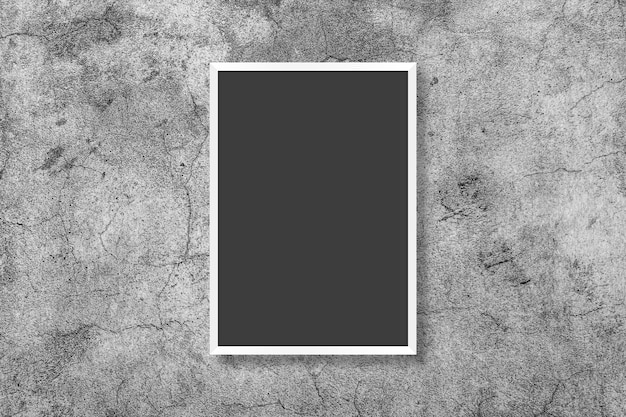 Blank white vertical rectangle poster mock up in black frame on gray