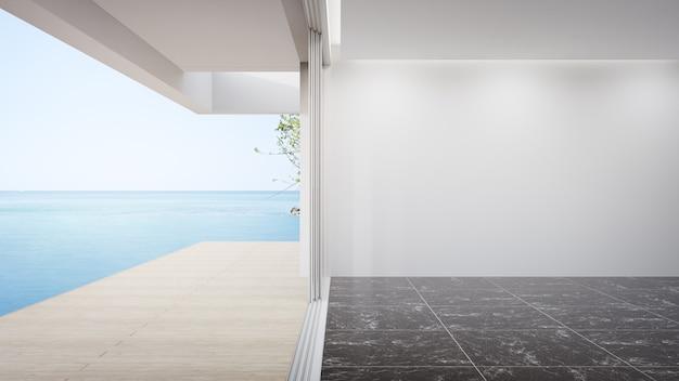広いリビングルームの空の黒い大理石の床に空白の白い壁