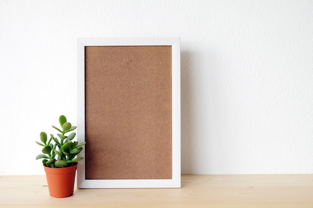 Blank white wooden frame and tree