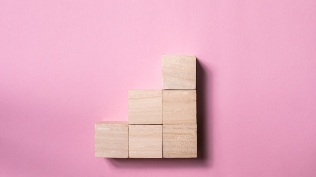 Blank wood cube mock up in stair shape on pink