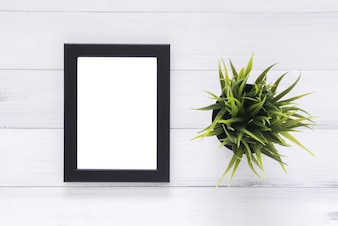 Blank wood picture frame on the table. can be used for your text or artwork. top view