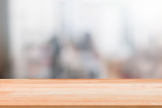 Blank wood table top on blurred people background with bokeh