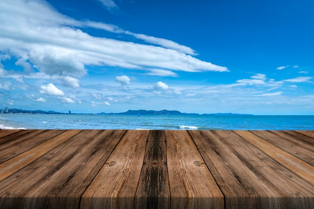 Blank of wood top table on the beach background