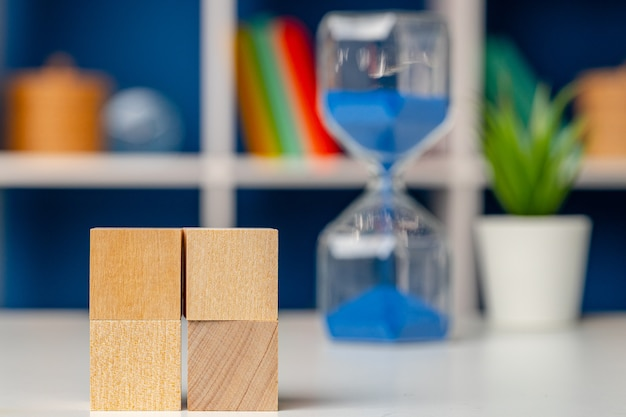 Blank wooden cubes with copy space for your design on office working table close up