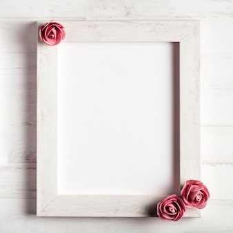 Blank wooden frame with beautiful roses