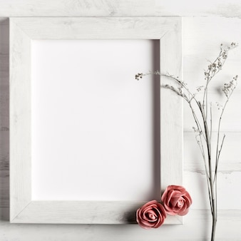 Blank wooden frame with roses and flowers