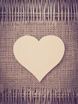 Blank wooden heart on fabric background