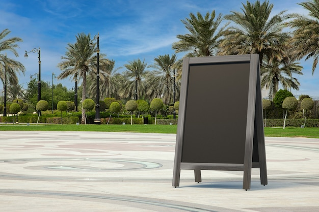 Blank wooden menu blackboards outdoor display as template for your design in empty city street with palm trees extreme closeup. 3d rendering