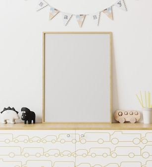 Blank wooden poster frame mockup in children's room interior with white wall and garland flags baby, chest of drawers with car print, toys, playroom interior, 3d rendering