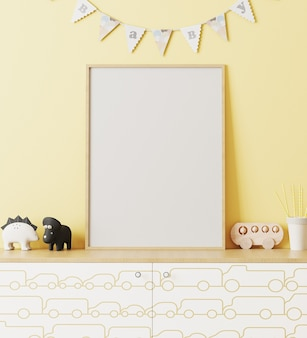 Blank wooden poster frame mockup in children's room interior with yellow wall and garland flags baby, chest of drawers with car print, toys, playroom interior, 3d rendering