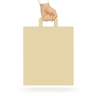 Blank yellow paper bag holding in hand