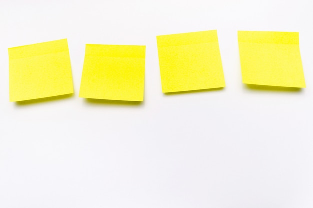 Blank yellow paper stickers on white background