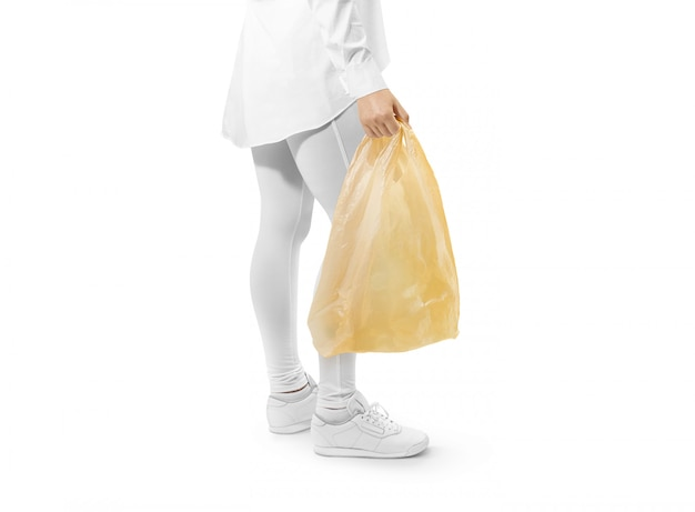 Blank yellow plastic bag  holding hand