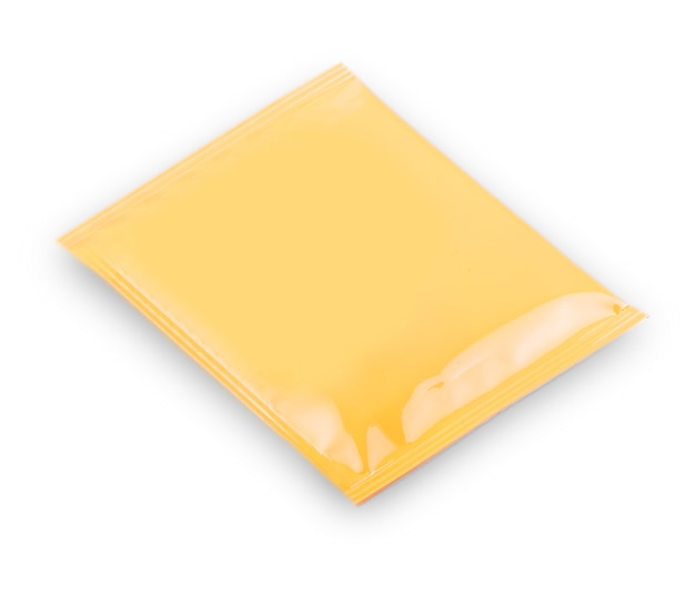 Blank yellow plastic sachet for medicine, drugs, coffee, sugar, salt, spices, isolated on white background . with clipping path