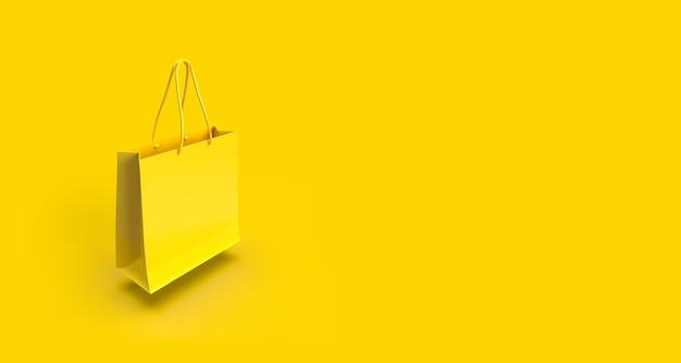 Пустая желтая хозяйственная сумка на желтом фоне с копией пространства.