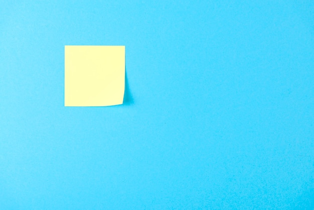 Blank yellow sticker on blue