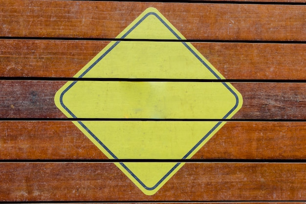 Blank yellow triangular caution sign, ready to fill with text.