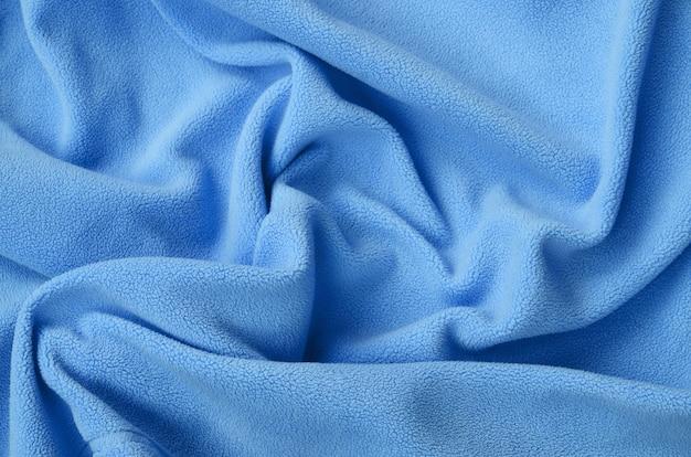 The blanket of furry blue fleece fabric