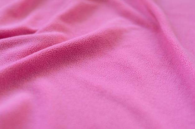 The blanket of furry pink fleece fabric.