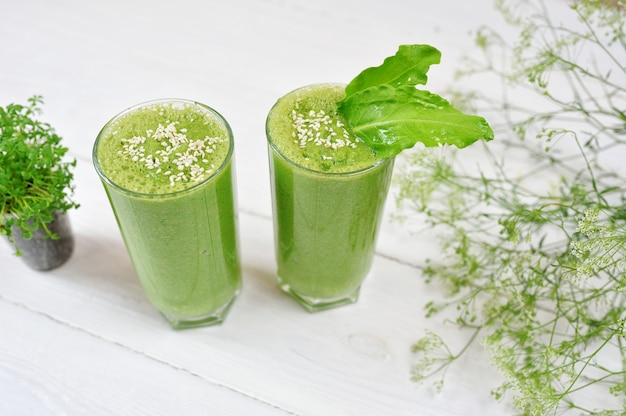 Blended green smoothie with ingredients or cocktail
