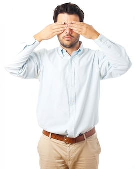 白い背景の上の盲目の男のジェスチャー