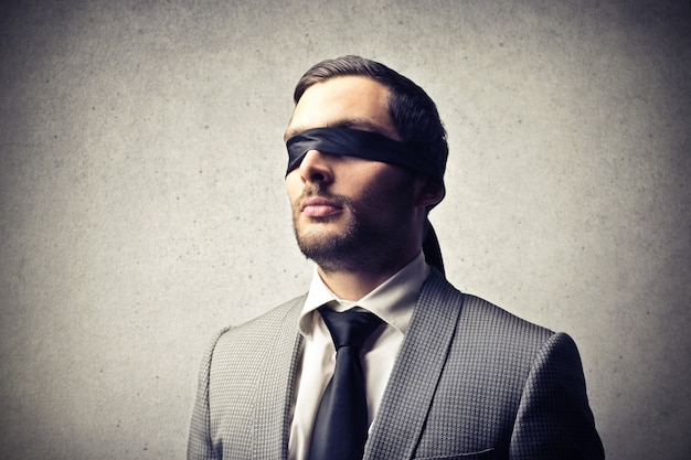 Blindfolded elegant man