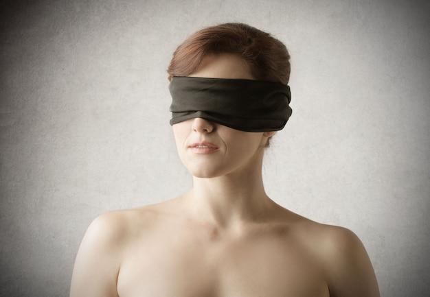 Blindfolded naked woman