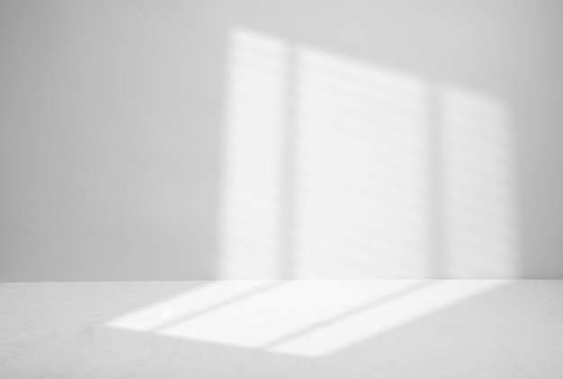 Blinds shadow on gray.