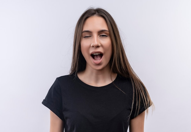 Blinked young caucasian girl wearing black t-shirt on isolated white wall