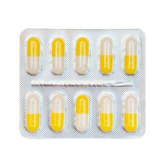 黄色と白のカプセルのブリスターパック