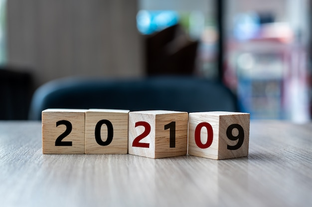 Block 2019 to 2020 word on table background.