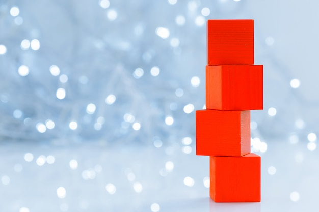 Blocks, creative greeting card on bokeh background