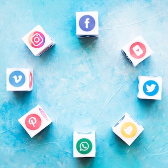 Blocks of social media icons arranged in circular shape over textured background