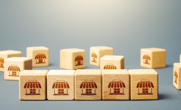 Blocks symbolizing shopping stores. building a successful business empire. franchise concept
