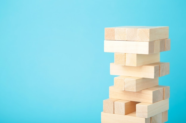 Blocks of wood on blue background. tower