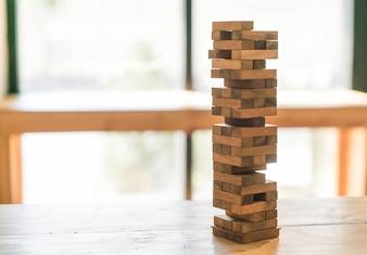 Blocks wood game (jenga) on wooden table