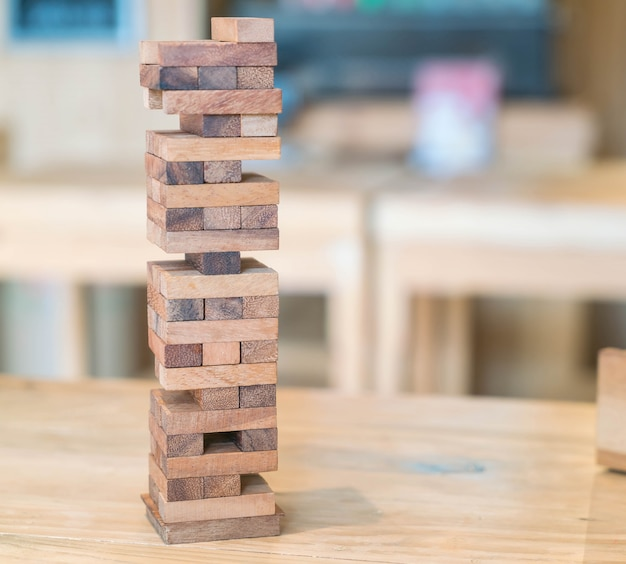 Blocks wood game (jenga) on wooden table