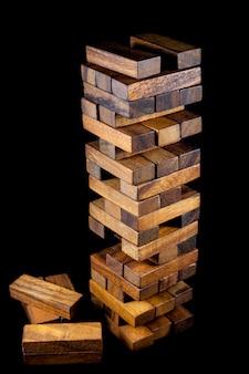 Blocks of wood (jenga) on black background