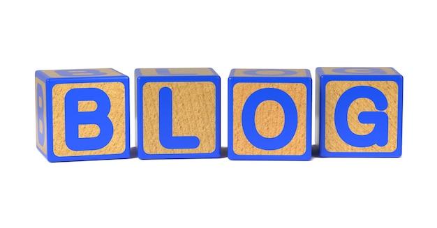 白で隔離される木製の子供のアルファベットブロックのブログ。