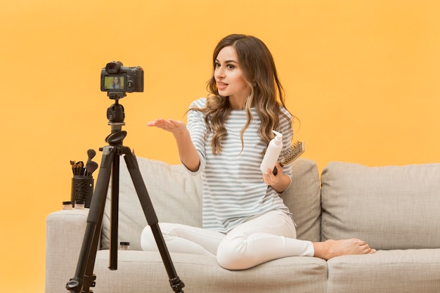 Blogger presenting hair products on camera