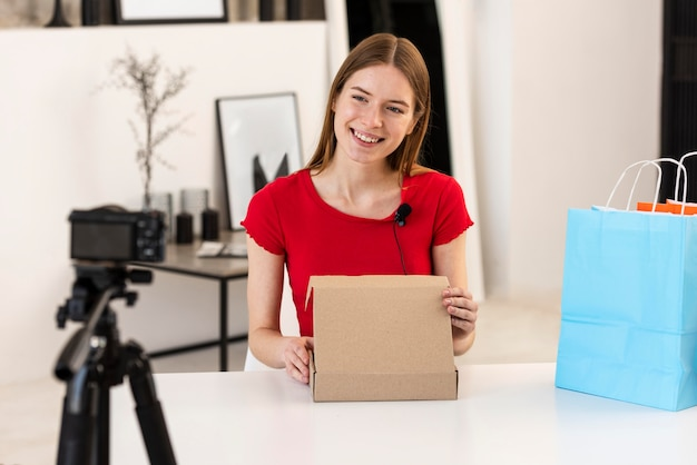Blogger presenting shopping on camera