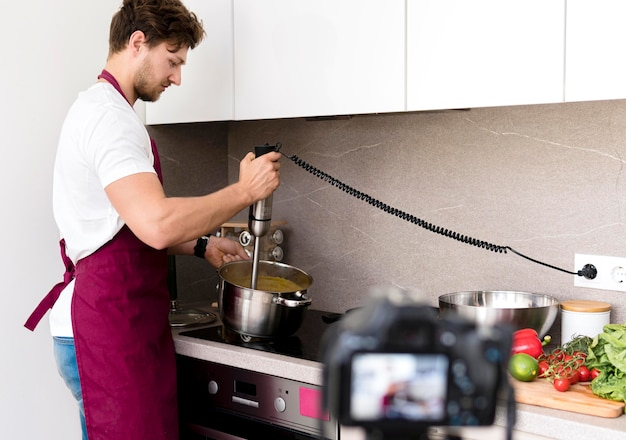 Blogger recording cooking video at home