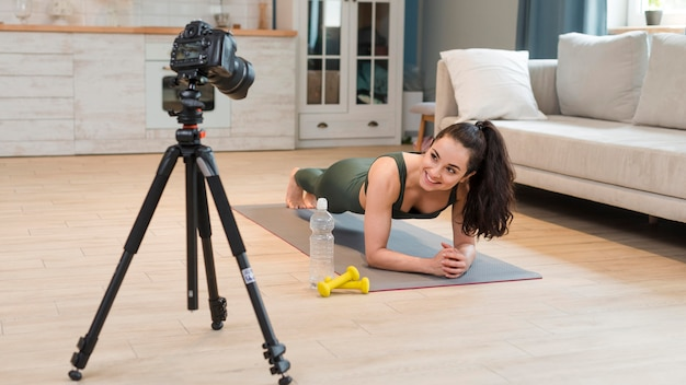 Blogger recording fitness class at home